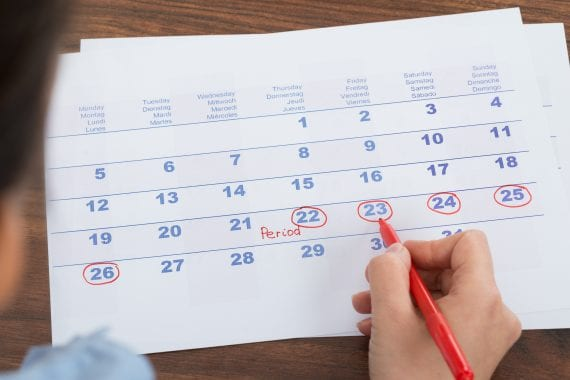 Close-up,Of,Person,Marking,Menses,Date,On,Calendar